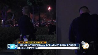 manhunt undeerway for armed bank robber