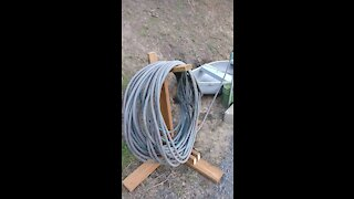 Garden hose holders and filled potato bed