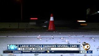 Large pothole damages several cars