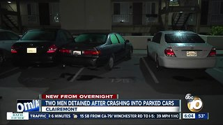 Car crashes into parked vehicles, 2 men detained