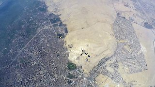 """""""That's a phar-aoh way to fall! Skydivers become the first civilians ever to fly directly over pyramids of Giza"""