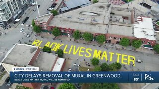 City delays removal of mural in Greenwood