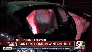 One dead, three injured after car crashes into home