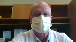 Southwest General Hospital doctor demonstrates how to properly put on a mask