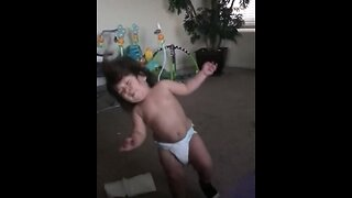 Toddler gets hit with giant ball in epic slow motion
