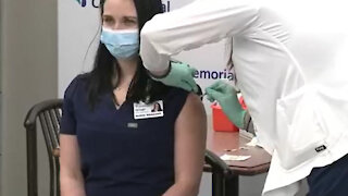 Nurse Passes Out after COVID Pfizer BioNTech Vaccine