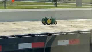 Jeep tows toy tractor on huge trailer