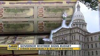 Gov. Whitmer strikes down nearly $1B in spending