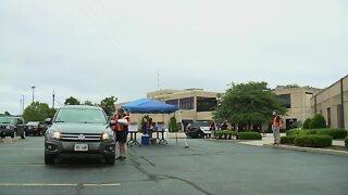 Hundreds of people attend drive-thru job fair