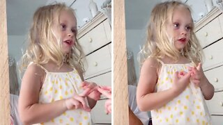 Little girl says her daily affirmations into the mirror