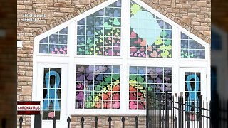 Assisted Living residents decorate windows