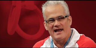 Former Olympic gymnastics coach charged
