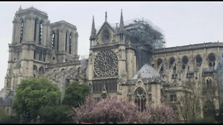French president promises to rebuild Notre Dame