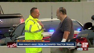 Man walks away from jackknifed tractor trailer