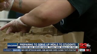 Preparing to serve up meals to students