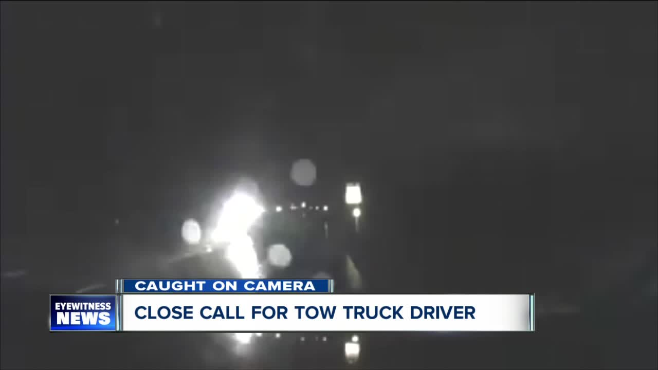 Close call for tow truck driver