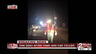 One dead after car collides with train