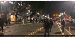 Portland antifa harass police cruiser.