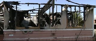 Mobile home burns after earthquake