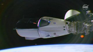 SpaceX Crew Capsule Successfully Docks At International Space Station