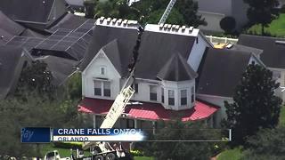 Crane crashes into house