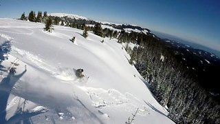Breathtaking moment avalanche drags snowboarder 100 metres down hill