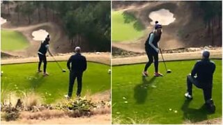Adorable marriage proposal on a golf course