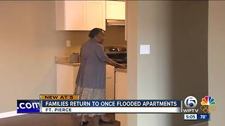 Families return to once flooded apartments