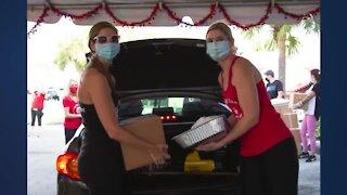 Thanksgiving Box Brigade distributes food to more than 2,700 families