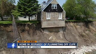 Somers home teetering over cliff along Lake Michigan could fall any day due to erosion