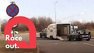 A car falls out a trailer just off a motorway