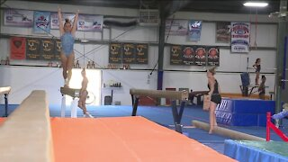 Local gymnasts are rooting for America's first Hmong American athlete