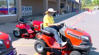 Local woman receives mower for her dedication, hard work