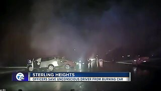 VIDEO: Sterling Heights police officers save man from burning car