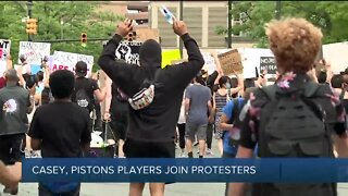 Dwane Casey, Pistons player join protesters in Detroit