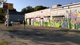 Local brigade transforming an Ohio City eyesore into a vibrant 100-foot mural