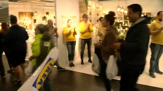 Customers entering IKEA with cheers