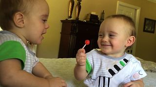 Twin Teases Brother With Lollipop