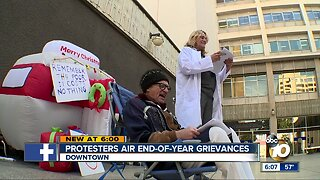 Protesters air end-of-year grievances outside City Hall