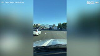 Guy hitches lift on back of truck
