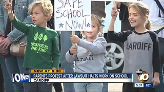 Parents protest over stalled construction