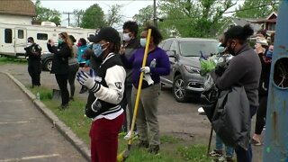 Community responds to violence with volunteer cleanup