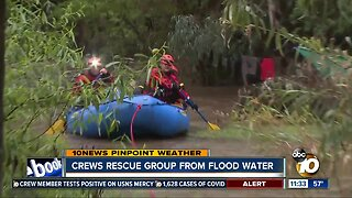 Crews rescue group from flood water