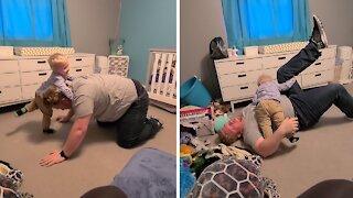 Toddler hilariously shows off impressive wrestling moves on dad