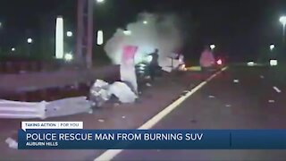 Police rescue man from burning SUV