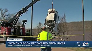 Woman's body recovered from river, police searching for suspect
