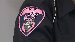 Akron police officers wearing pink patches for breast cancer awareness month