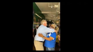 Maskless Terry McAuliffe Hugs People Inside a Packed Restaurant