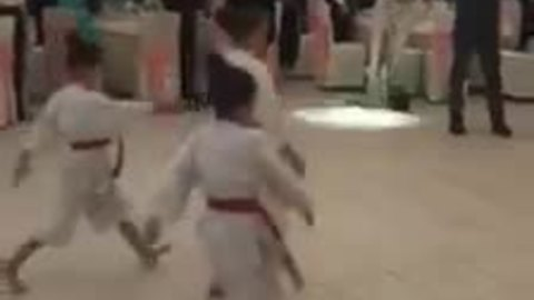 Newlyweds introduced by children's karate display