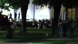 Police attempt to clear protesters in downtown Kenosha